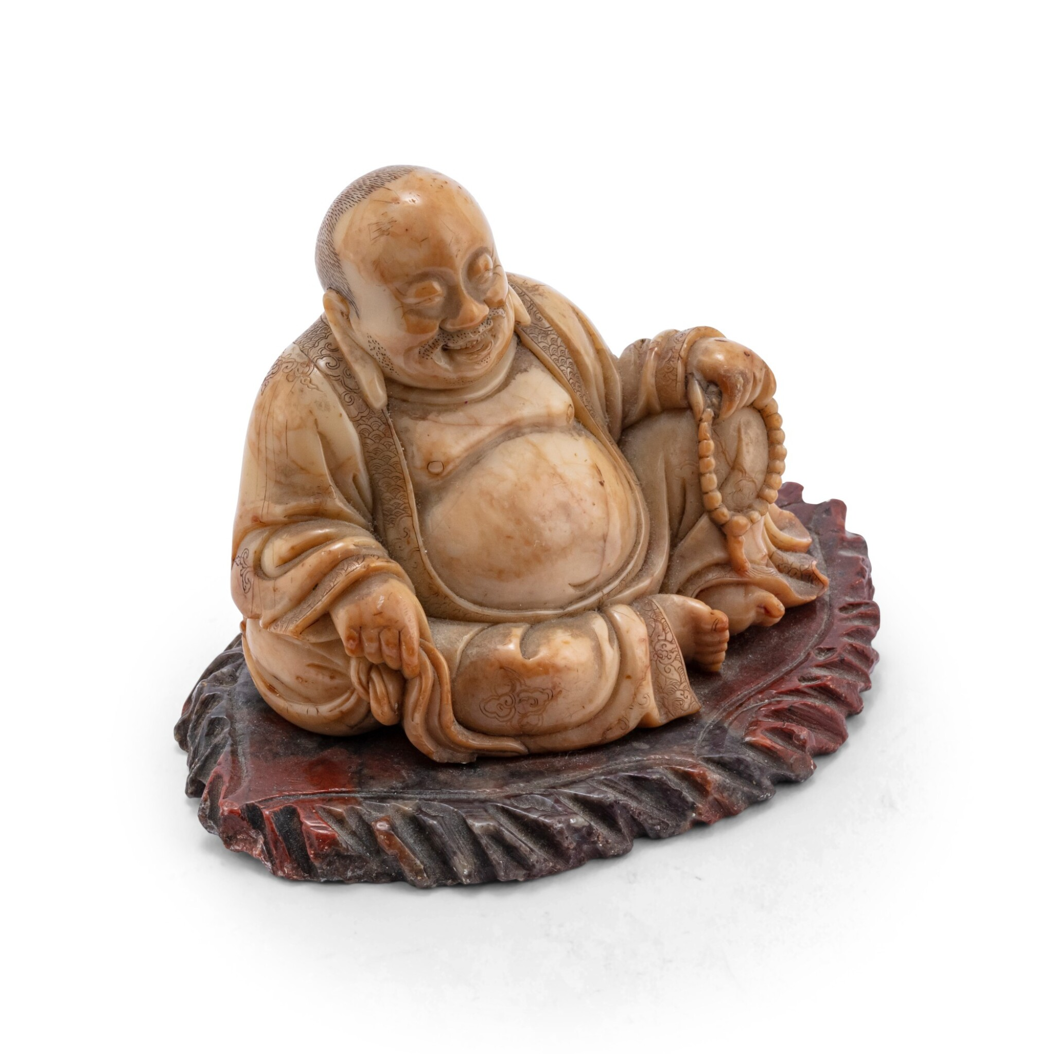 View 1 of Lot 158. Statuette de Budai en stéatite Dynastie Qing, XVIIIE siècle | 清十八世紀 壽山石雕布袋和尚坐像 | A soapstone figure of seated budai, Qing Dynasty, 18th century.
