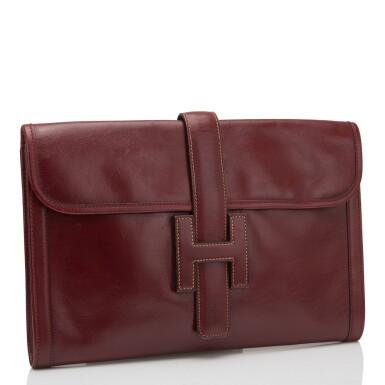 View 2. Thumbnail of Lot 24. Hermès Vintage Rouge H Box Jige Elan Clutch 29cm.