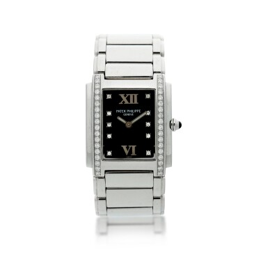 View 1. Thumbnail of Lot 75. REFERENCE 4910/010 TWENTY-4 A STAINLESS STEEL AND DIAMOND-SET BRACELET WATCH, MADE IN 2001.