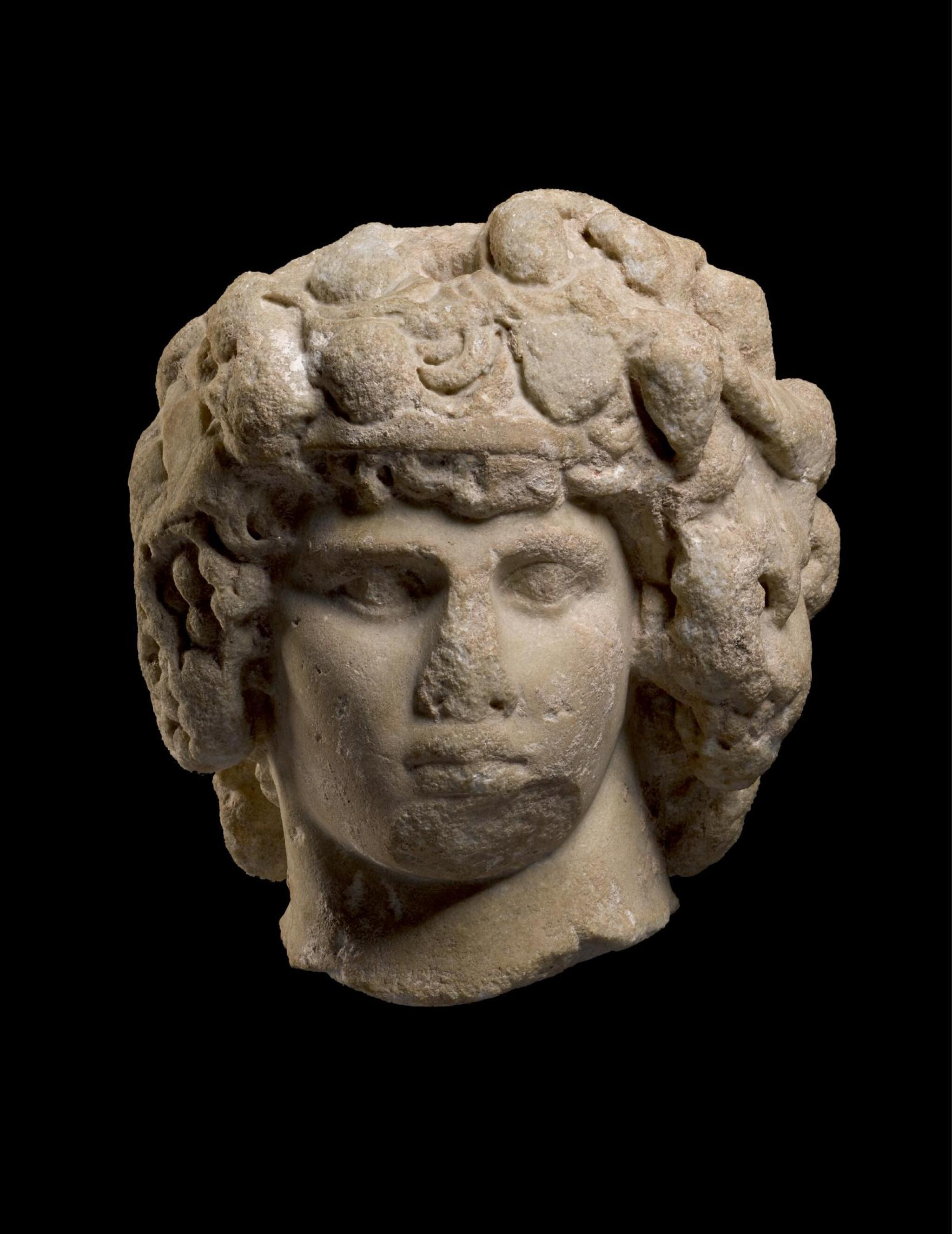 View full screen - View 1 of Lot 251. A MONUMENTAL ROMAN MARBLE PORTRAIT HEAD OF ANTINOUS AS DIONYSOS-OSIRIS, CIRCA A.D. 130–138.