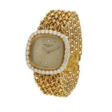 View 3. Thumbnail of Lot 99. Reference 4524/1  A yellow gold and diamond-set cushion shaped wristwatch, Circa 1982.