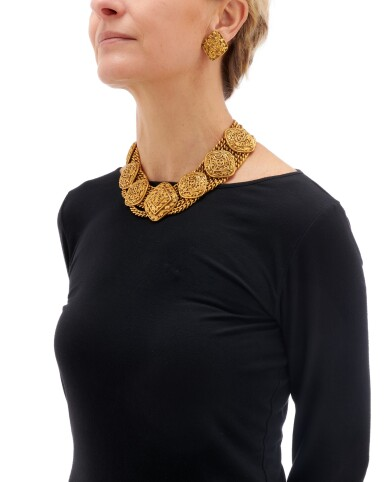 View 5. Thumbnail of Lot 66. Gold-tone metal necklace and two pairs of earrings.
