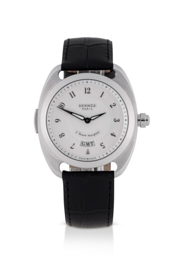 View 1. Thumbnail of Lot 99. HERMÈS   DRESSAGE L'HEURE MASQUÉE, REF DR5.810 LIMITED EDITION STAINLESS STEEL DUAL TIME WRISTWATCH WITH HIDDEN HOUR HAND CIRCA 2015.