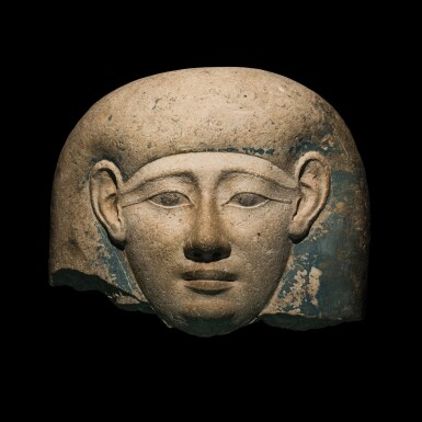 View 1. Thumbnail of Lot 45. An Egyptian Limestone Sarcophagus Mask, 30th Dynasty/early Ptolemaic Period, circa 380-250 B.C..