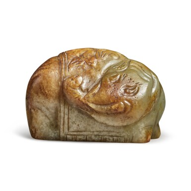 View 1. Thumbnail of Lot 170. A russet and celadon jade 'elephant' carving, 19th / 20th century.