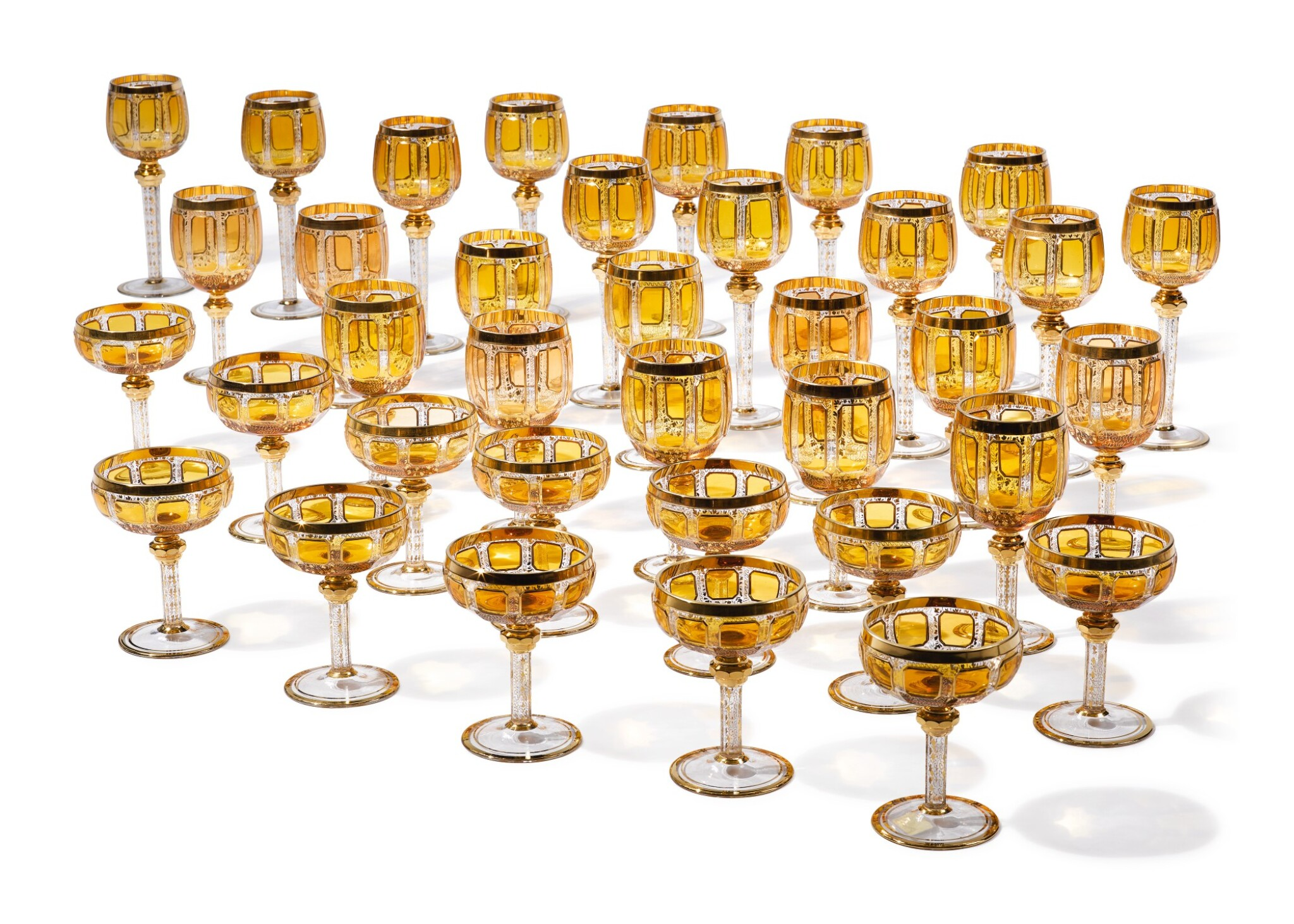 View full screen - View 1 of Lot 270. A BOHEMIAN AMBER-TINTED AND GILT GLASS PART-TABLE SERVICE, LATE 19TH/20TH CENTURY.