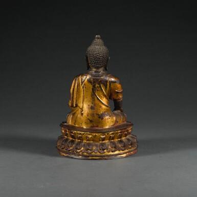 View 2. Thumbnail of Lot 24. A GILT-LACQUERED BRONZE FIGURE OF SHAKYAMUNI,  MING DYNASTY, 15TH/16TH CENTURY  | 明十五/十六世紀 漆金銅釋迦牟尼佛坐像.
