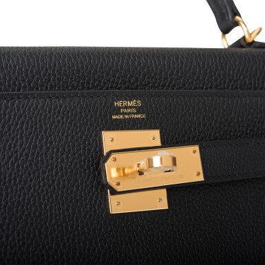View 7. Thumbnail of Lot 52. HERMÈS   BLACK RETOURNE KELLY 28CM OF TOGO LEATHER WITH GOLD HARDWARE.
