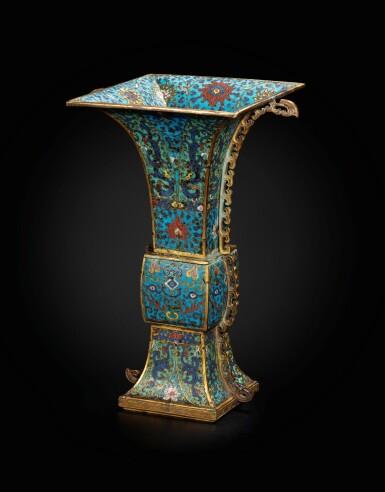 View 1. Thumbnail of Lot 178. A large gilt-bronze and cloisonné enamel ceremonial vase, fanggu 17th century | 十七世紀 掐絲琺瑯獸面紋出戟方觚.