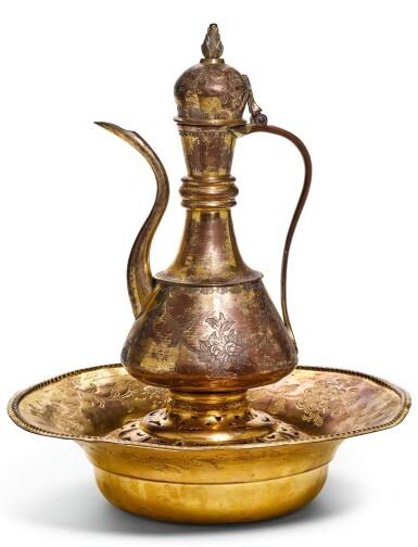 AN OTTOMAN GILT-COPPER (TOMBAK) LIDDED EWER, WITH ASSOCIATED BASIN AND FILTER, TURKEY, 18TH CENTURY