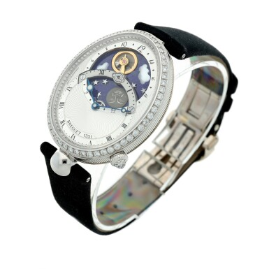 View 4. Thumbnail of Lot 107. Reference 8998 Reine De Naples A white gold and diamond-set automatic oval wristwatch with moon phases and 24-hour indication, Circa 2015.