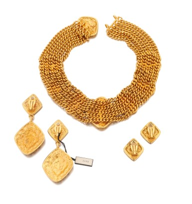 View 3. Thumbnail of Lot 66. Gold-tone metal necklace and two pairs of earrings.