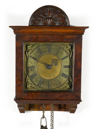 View 1. Thumbnail of Lot 60. Thomas Tompion: A small walnut 30-hour wall clock, London, circa 1700.