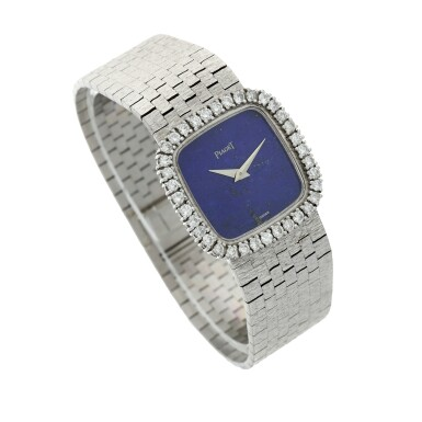 View 3. Thumbnail of Lot 111. A white gold and diamond-set cushion shaped bracelet watch with lapis lazuli dial, Circa 1970.