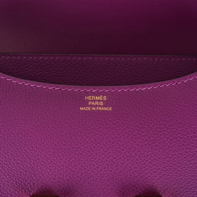 View 9. Thumbnail of Lot 21. Hermès Anemone Constance 18cm of Evercolor Leather with Gold Hardware.