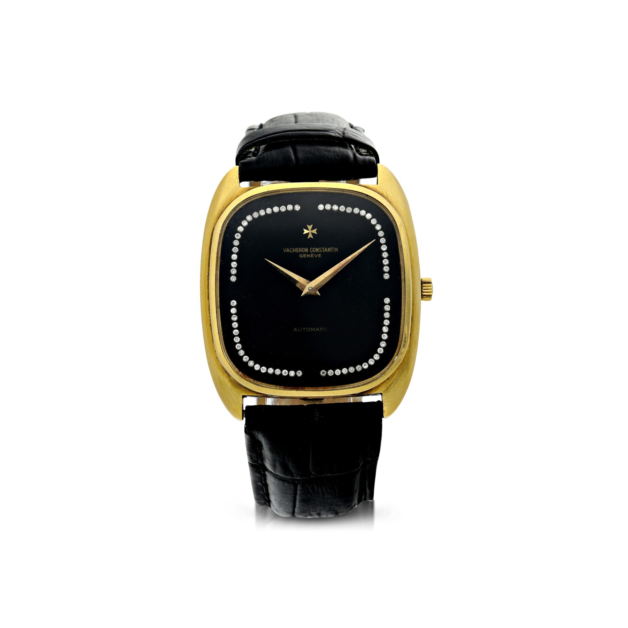 View full screen - View 1 of Lot 804. REFERENCE 44003 A YELLOW GOLD CUSHION SHAPED AUTOMATIC WRISTWATCH WITH DIAMOND-SET ONYX DIAL, CIRCA 1985.