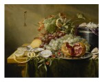 LAURENS CRAEN  |  A STILL LIFE WITH A POMEGRANATE AND OTHER FRUITS, OYSTERS, SHRIMPS AND SHELLS ON A VELVET BOX ON A TABLE