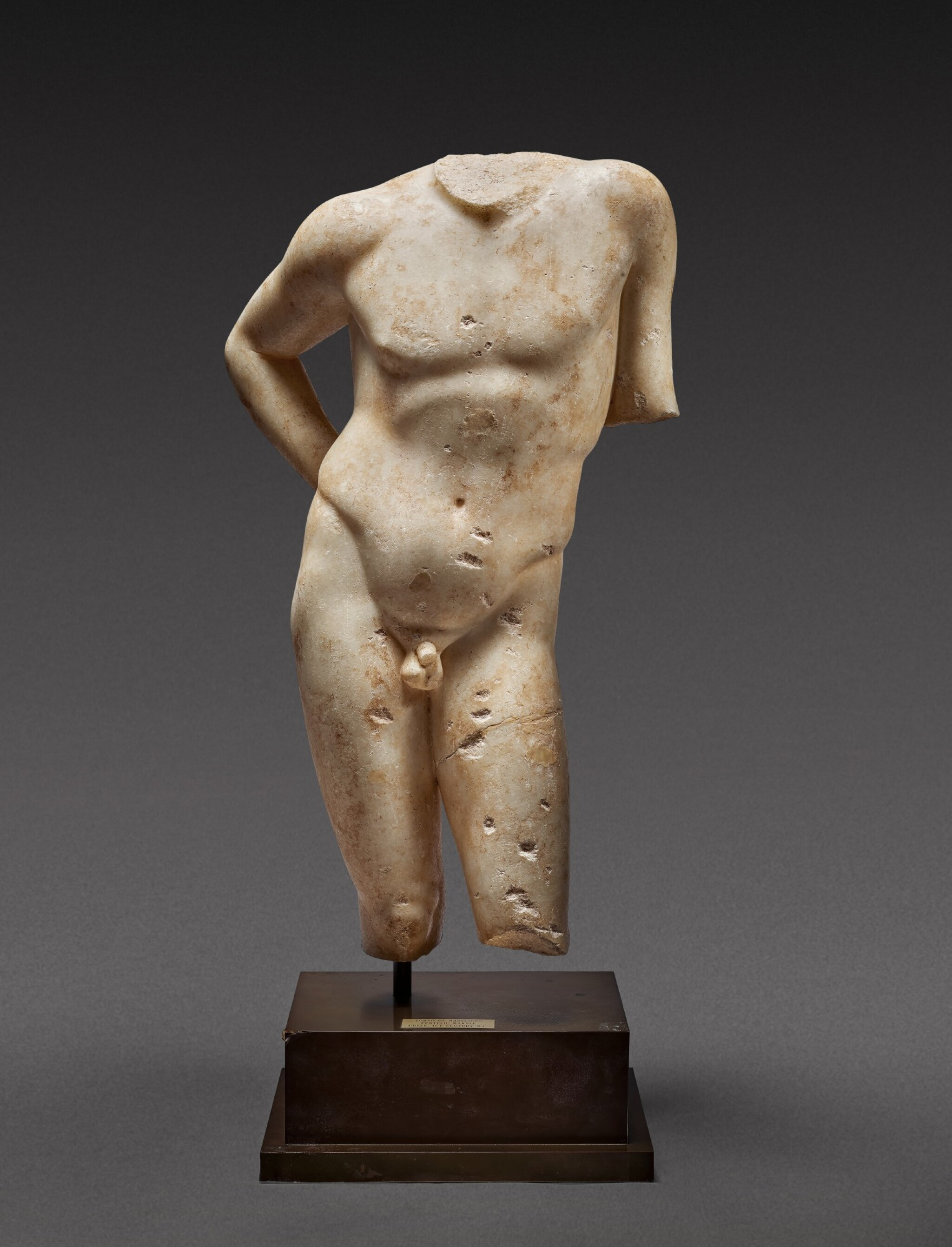 View full screen - View 1 of Lot 27. A Roman Marble Torso of Narcissus, circa 1st Century A.D..