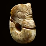 A RARE AND LARGE CALCIFIED YELLOW JADE ZHULONG ('PIG DRAGON') NEOLITHIC PERIOD, HONGSHAN CULTURE | 新石器時代紅山文化 黃玉豬龍