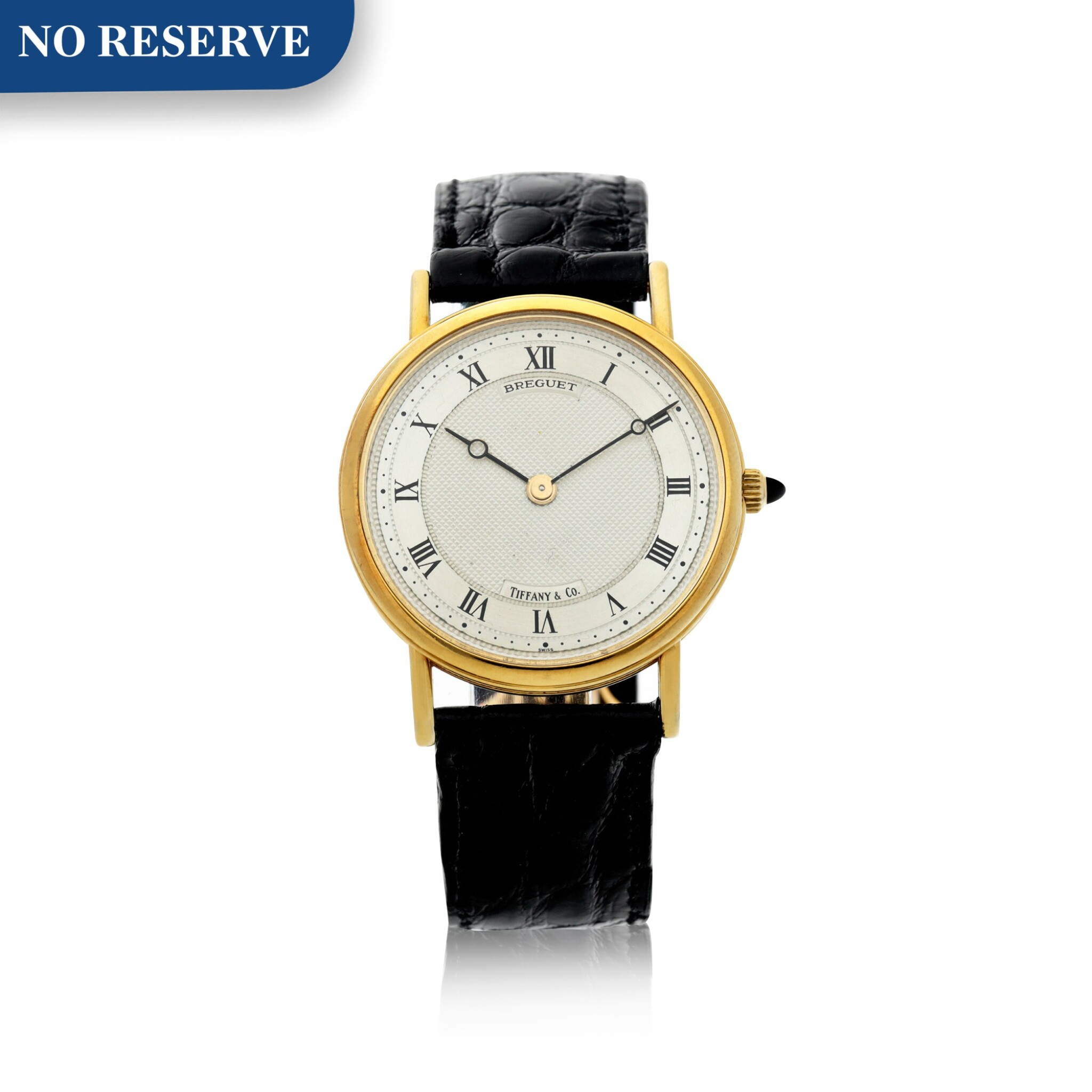 View full screen - View 1 of Lot 204. RETAILED BY TIFFANY & CO.: A YELLOW GOLD WRISTWATCH, CIRCA 2000.