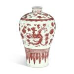 AN UNDERGLAZE-RED 'PHOENIX' MEIPING, QING DYNASTY, 18TH CENTURY   清十八世紀 釉裏紅穿花夔鳳紋梅瓶