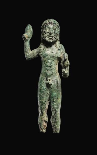 A GREEK BRONZE FIGURE OF ZEUS, 6TH CENTURY B.C.