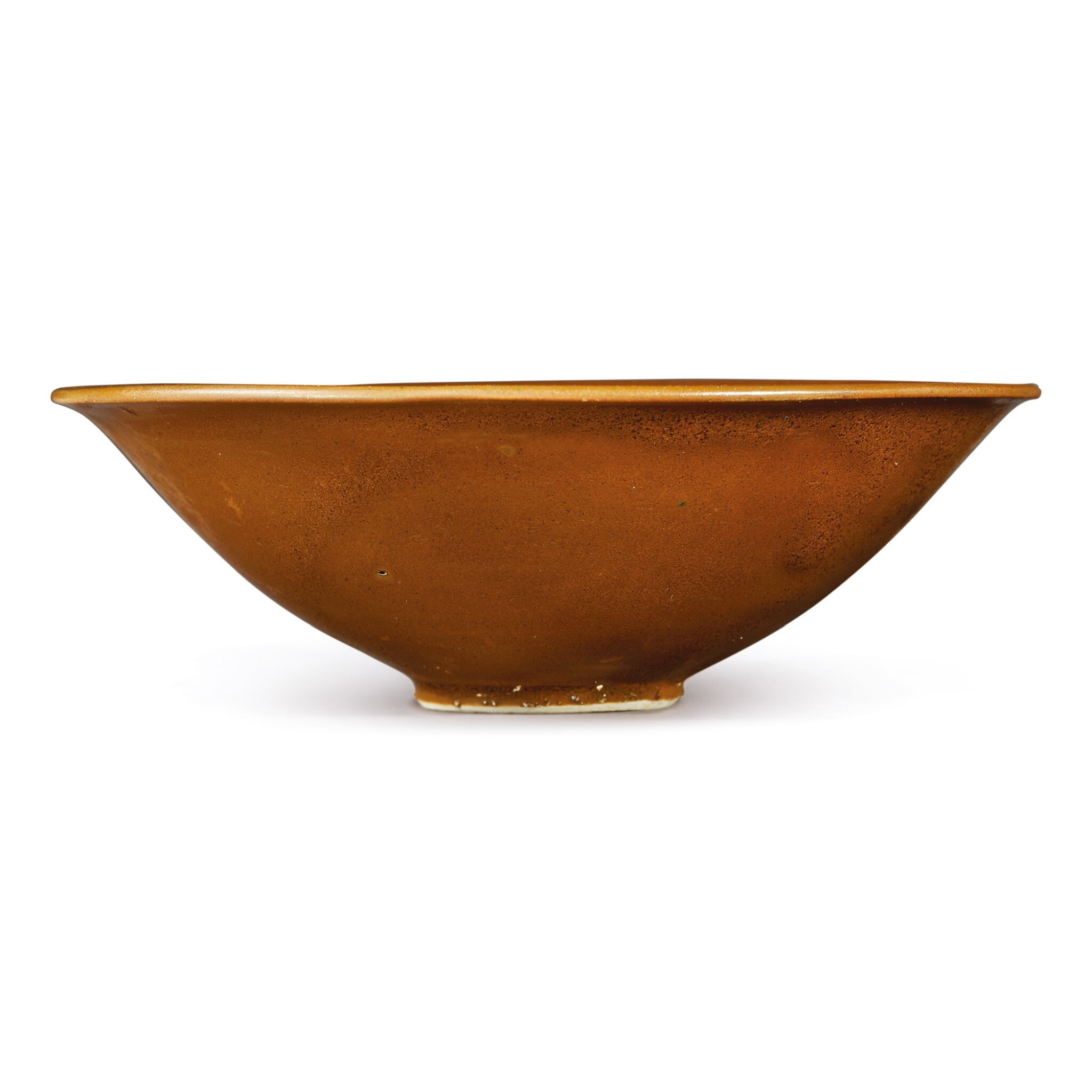 View 1 of Lot 709. A PERSIMMON-GLAZED 'DING' BOWL, NORTHERN SONG DYNASTY.