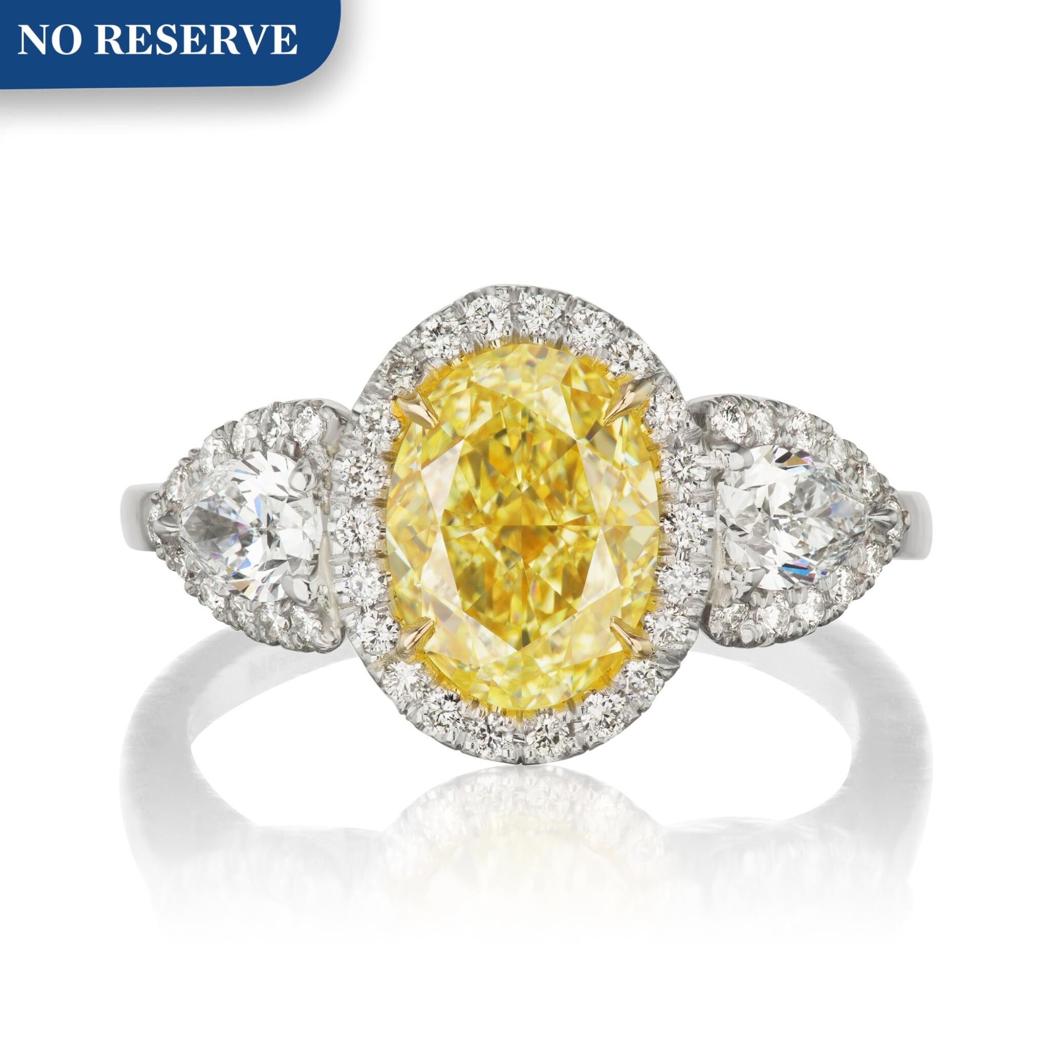View full screen - View 1 of Lot 47. Harry Winston   Fancy Yellow Diamond and Diamond Ring.