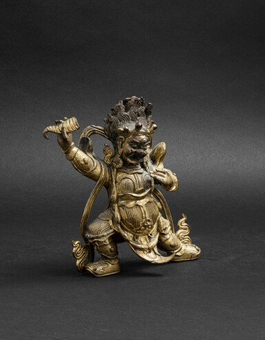 View 2. Thumbnail of Lot 47. Figure de Begtse en bronze doré Dynastie Qing, XVIIIE siècle | 清十八世紀 鎏金銅大紅司命主立像 | A git-bronze figure of Begtse, Qing Dynasty, 18th century.
