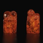 A pair of amber 'Buddhist lion' seals, Qing dynasty, 18th century | 清十八世紀 琥珀雕瑞獸鈕印料一對