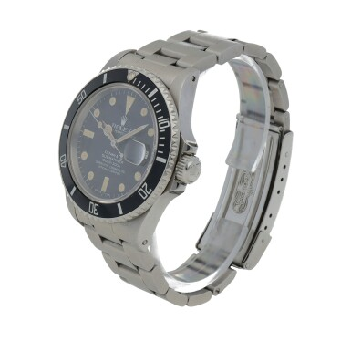 View 2. Thumbnail of Lot 518. Retailed by Tiffany & Co.: Submariner, Ref. 16800 Stainless steel wristwatch with date and bracelet Circa 1985   勞力士 零售商為蒂芙尼:16800型號「Submariner」精鋼鍊帶腕錶備日期顯示,年份約1985.