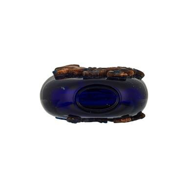 View 3. Thumbnail of Lot 1019. An aventurine overlay purple-blue glass 'chilong' snuff bottle Qing dynasty, 18th century | 清十八世紀 透明紫地套金星玻璃螭龍紋鼻煙壺.