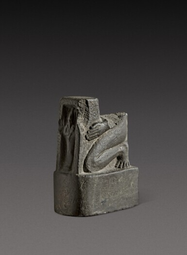 View 4. Thumbnail of Lot 47. A Fragmentary Egyptian Basalt Naophoros, 1st half of the 26th Dynasty, circa 664-600 B.C..