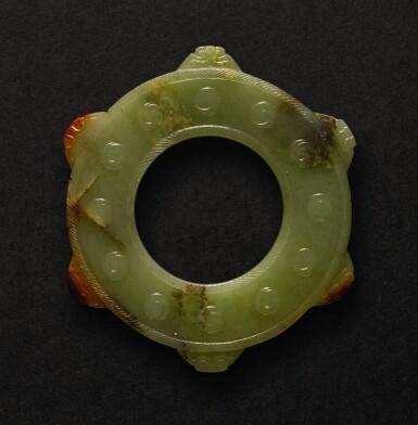 AN ARCHAISTIC YELLOW JADE 'NOTCHED' DISC, BI MING DYNASTY |  明 黃玉仿古瑞獸紋壁
