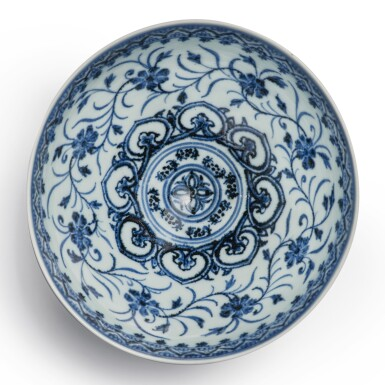 View 3. Thumbnail of Lot 130. An exceptional and rare blue and white 'floral' bowl, Ming dynasty, Yongle period | 明永樂 青花花卉紋蓮子盌.
