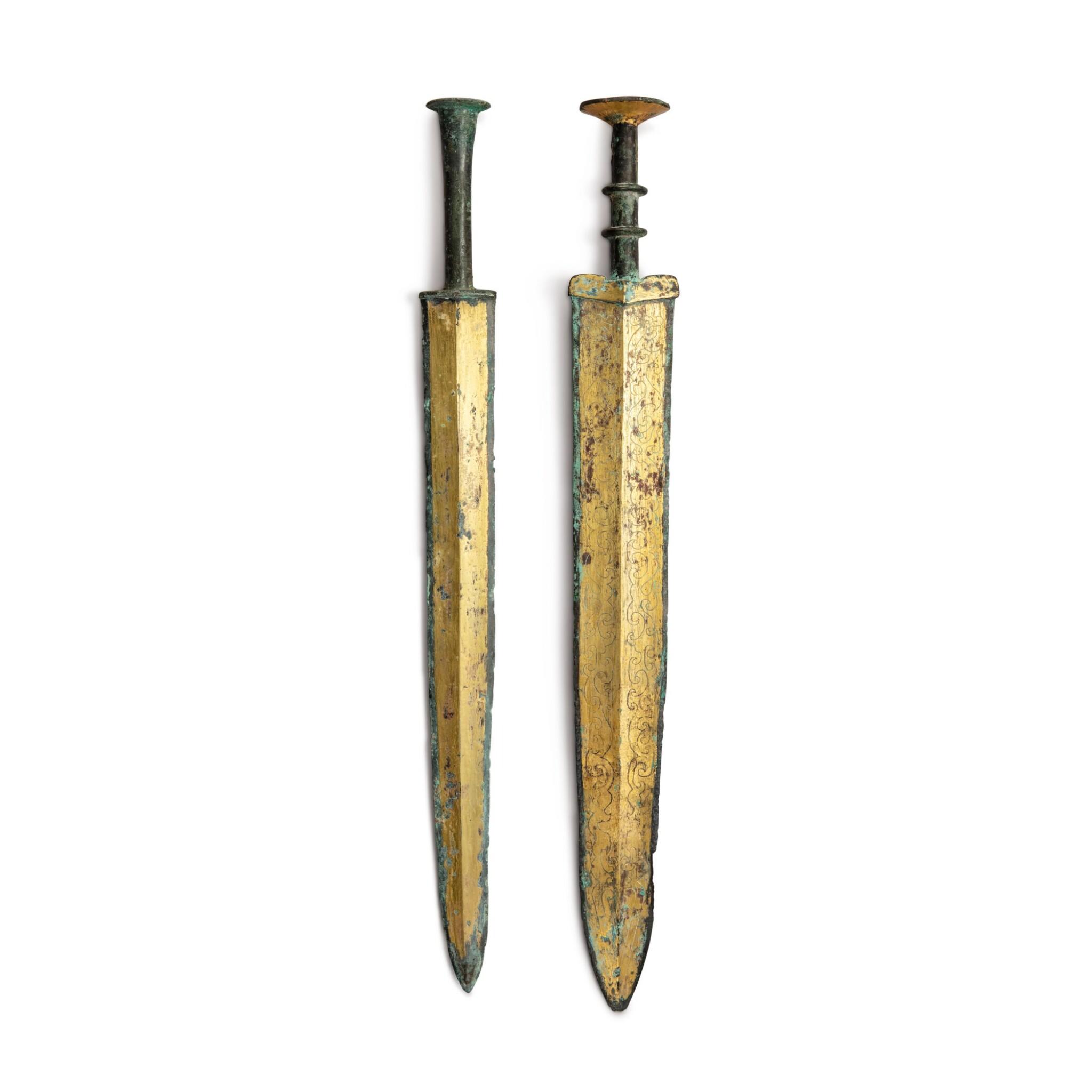 View full screen - View 1 of Lot 22. Two archaic gilt-bronze swords (Jian), Warring States period - Western Han dynasty | 戰國至西漢 銅鎏金龍紋劍及銅鎏金劍.