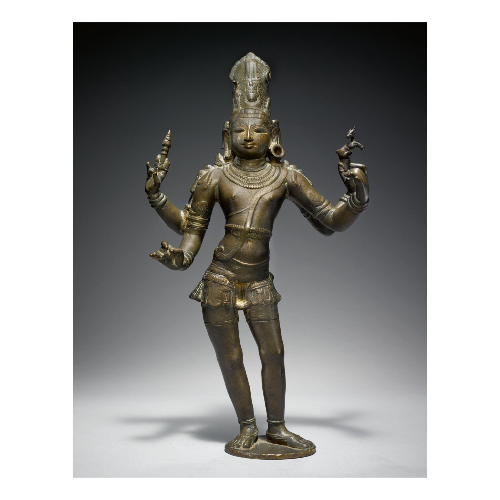 View full screen - View 1 of Lot 355. A COPPER ALLOY FIGURE OF SHIVA VINADHARA SOUTH INDIA, TAMIL NADU, CHOLA, CIRCA 12TH CENTURY.