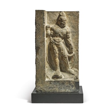 A LIMESTONE RELIEF CARVING OF A GUARDIAN,  TANG DYNASTY