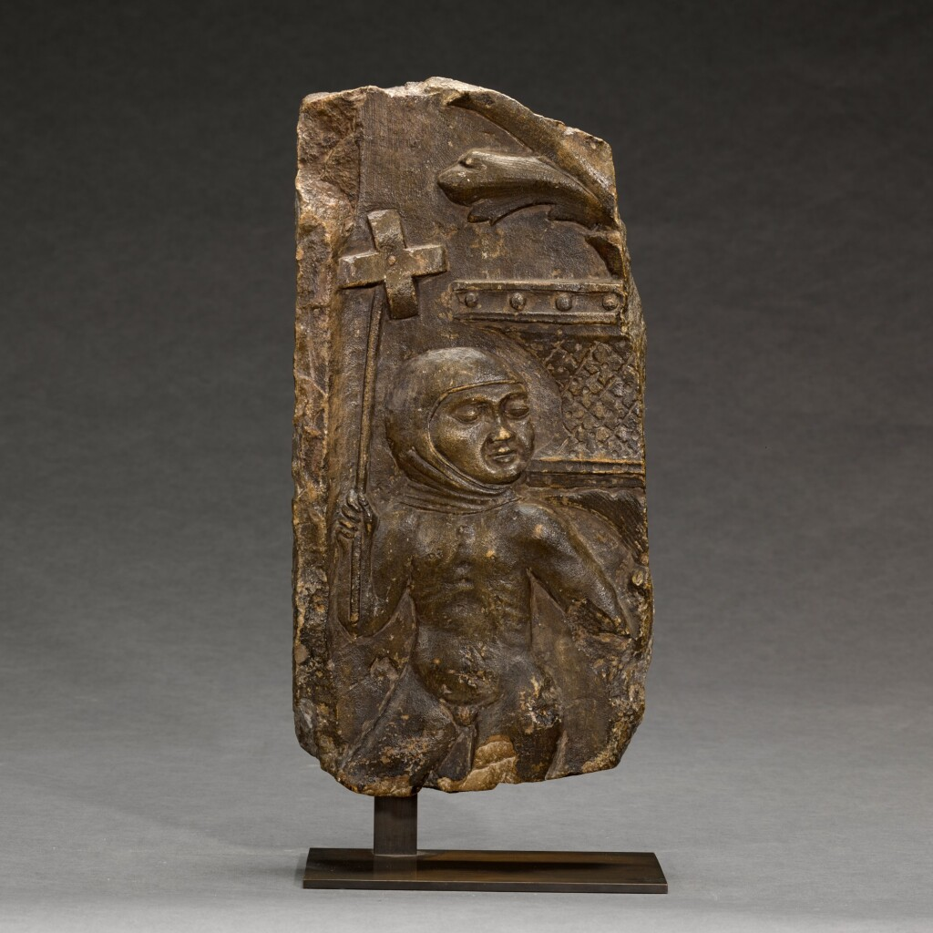 ITALIAN, LOMBARDY, SECOND HALF 15TH CENTURY | RELIEF FRAGMENT WITH A BOY HOLDING A WHIRLIGIG
