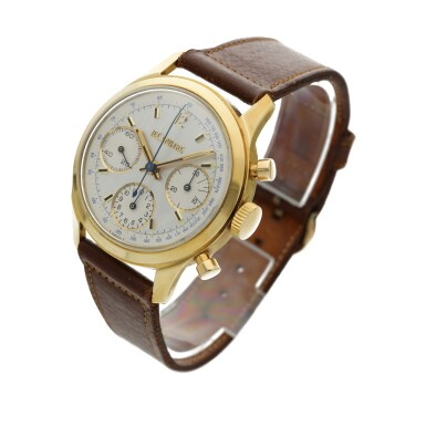 View 2. Thumbnail of Lot 101. A yellow gold chronograph wristwatch, Circa 1955 .