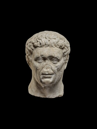 View 1. Thumbnail of Lot 75. A Monumental Marble Portrait Head of the Emperor Nerva, late 1st Century A.D..