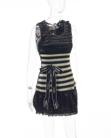 View 2. Thumbnail of Lot 4. Black and off-white striped vinyl dress and ribbon bow brooch.