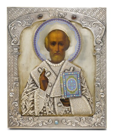 View 1. Thumbnail of Lot 255. A gem-set, silver and champlevé enamel icon of Saint Nicholas, Dmitry Smirnov, Moscow, 1899-1908.