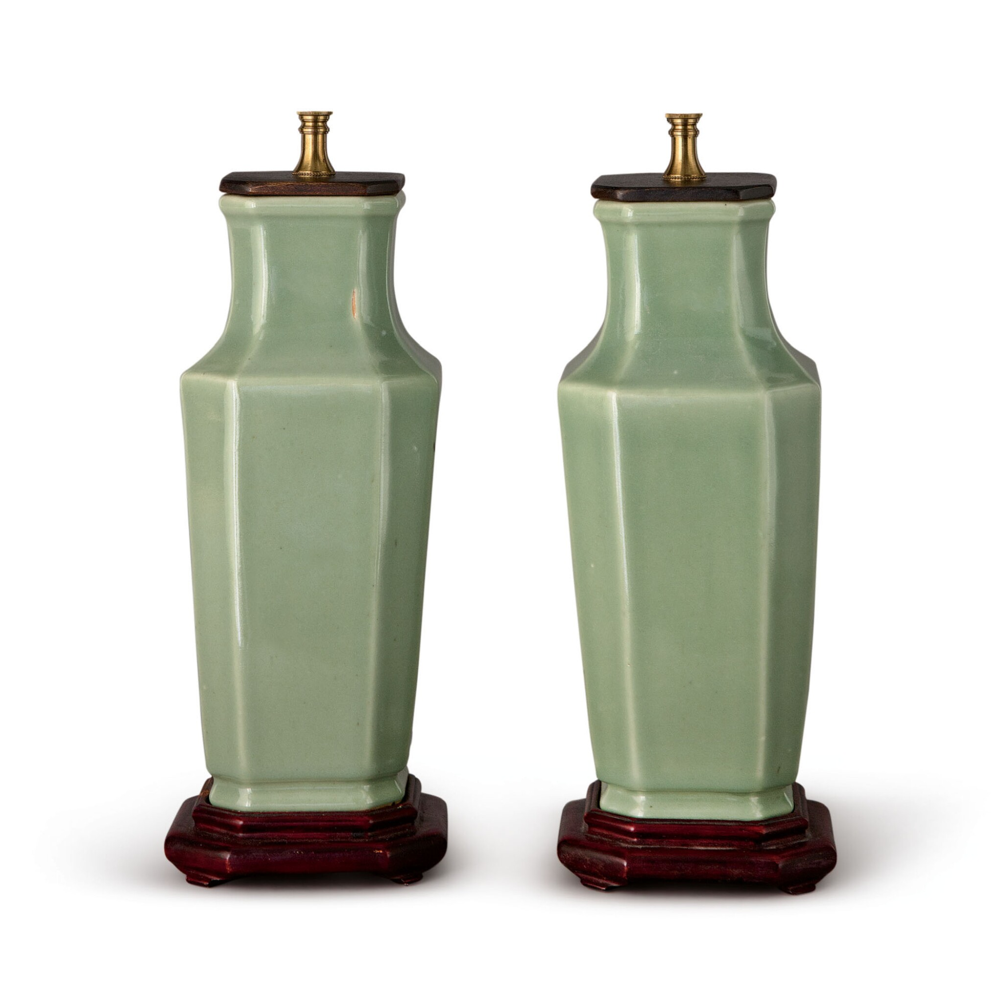 View full screen - View 1 of Lot 576. A PAIR OF CHINESE CELADON-GLAZED OCTAGONAL VASES, 19TH/20TH CENTURY.
