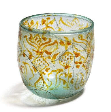 A FATIMID LUSTRE-DECORATED GLASS CUP, SYRIA, 9TH-11TH CENTURY