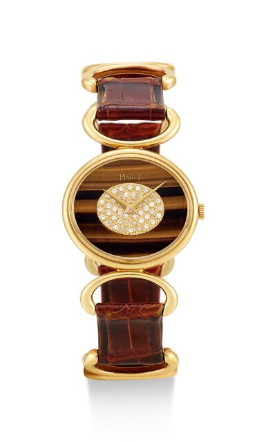 PIAGET | REFERENCE 9802 B, A YELLOW GOLD AND DIAMOND-SET WRISTWATCH WITH TIGER EYE DIAL, CIRCA 1972