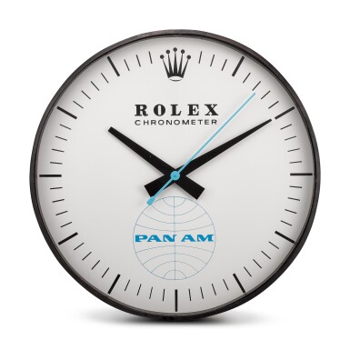 View 1. Thumbnail of Lot 8136. HANDOVER MANUFACTURE INC FOR ROLEX | REFERENCE G-062, A LARGE BLACKENED METAL WALL CLOCK, MADE FOR PAN-AM AMERICAN AIRWAYS, CIRCA 1965.