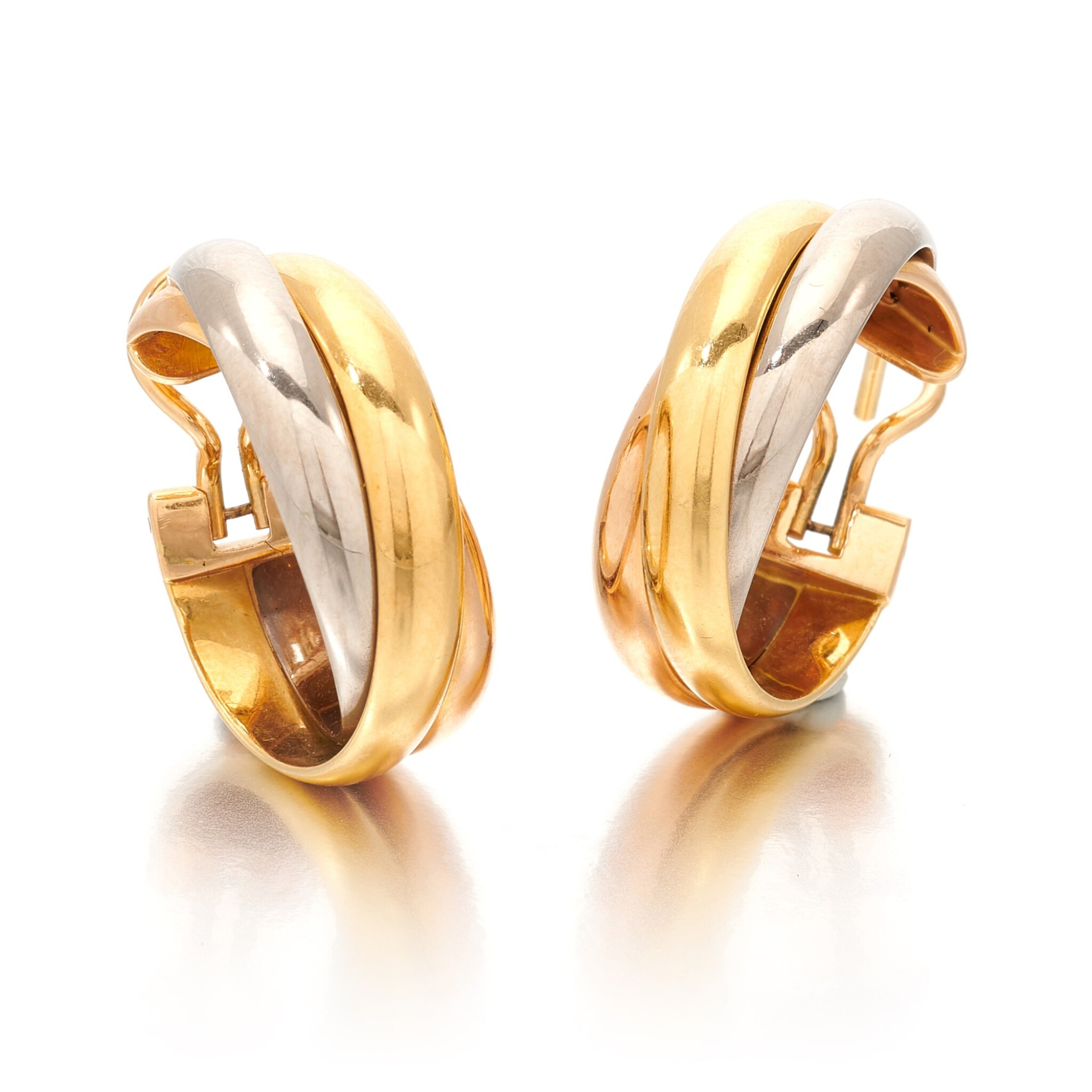 View full screen - View 1 of Lot 100. CARTIER   PAIR OF THREE- COLOR GOLD EARRINGS   (PAIO DI ORECCHINI IN ORO TRICOLORE) .