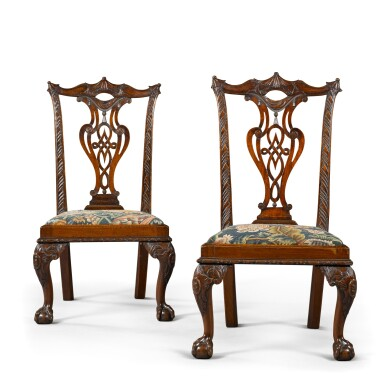 View 1. Thumbnail of Lot 71. A pair of George II carved mahogany 'child's' chairs, circa 1750.