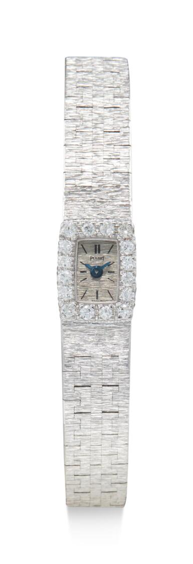 View 1. Thumbnail of Lot 8091. PIAGET | REFERENCE 1308 A 6, A WHITE GOLD AND DIAMOND-SET BRACELET WATCH, CIRCA 1960.